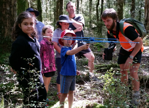 Adam Ross showing the school kids how to use the Yagi aerial which picks up the transmitter signal. Photo: Bronwyn Slack