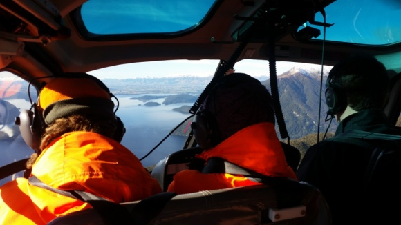 Bex Jackson, Jenny Rickett and pilot Gav Burgess fly out over Lake Manapouri