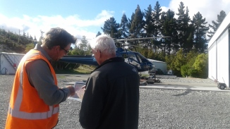 Glen showing our pilot Mark where we need to be dropped off. Photo: DOC