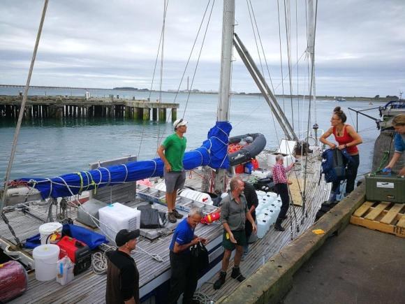 Loading the boat with the Adams Island albatross team.jpg
