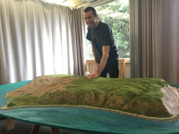 Model maker working on the new model of Mana Island. 📷: Doug Royson.